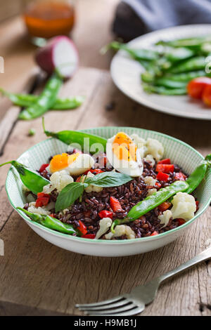 Thai Rice berry with Boiled egg  and Snow pea salad - Stock Photo