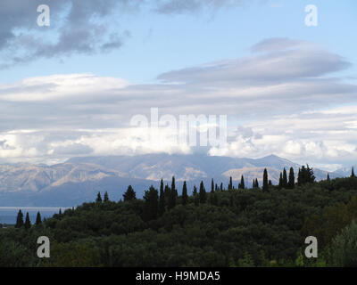 View of Greek countryside and Albanian mountains from Xanthates village, Corfu, Greece - Stock Photo