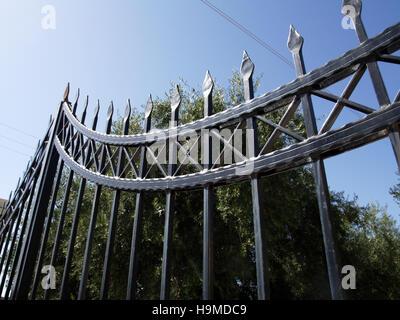 Black wrought iron railings at property in Corfu Greece - Stock Photo