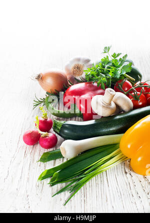 Fresh mixed vegetables collection on white wooden background - Stock Photo