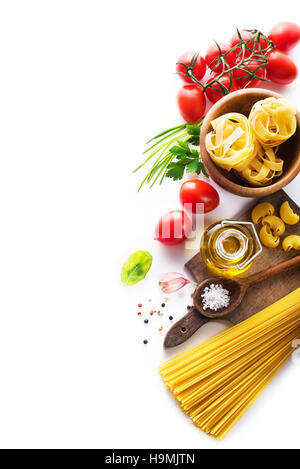 Raw Pasta with ingredients on white background - Stock Photo
