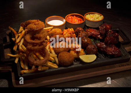 Fried Chicken Strips, Chicken Wings, Onion Rings, Fish Sticks And French Fries Sharing, Pune, India - Stock Photo