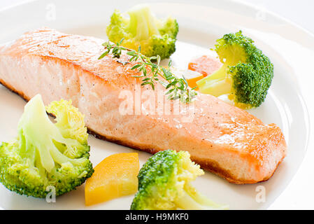 Grilled salmon steak with vegetables close up - Stock Photo