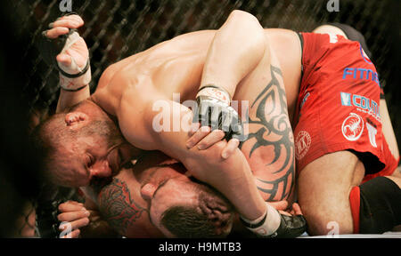 Randy Couture, top, fights Tim Sylvia during Ultimate Fighting Championship UFC 68 at the Nationwide Arena in Columbus, - Stock Photo