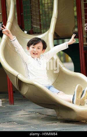 The little boy slides - Stock Photo
