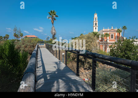 The famous wishing bridge in Jaffa with St. Peter's Church seen in the background. Israel - Stock Photo