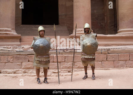 Nabatean soldiers in front The Treasury building at Petra, Jordan - Stock Photo