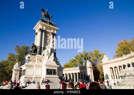 Madrid Spain Monument to King Alfonso XII, Park of Retiro tourists visiting day scene Park del Buen Retiro - Stock Photo