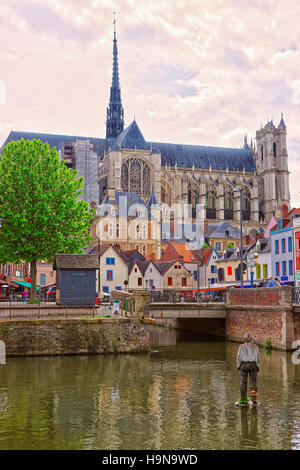 Amiens Cathedral of Notre Dame and traditional houses on La place du Don Street at the embankment of Somme canal, - Stock Photo