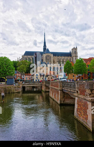 Amiens, France - May 9, 2012: Amiens Cathedral of Notre Dame and traditional houses on La place du Don Square at - Stock Photo