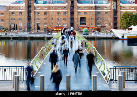 London, UK - September 21, 2016 - People crossing the North Dock Footbridge from Canary Wharf to West India Quay - Stock Photo