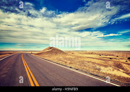 Vintage stylized empty road, travel concept, USA. - Stock Photo