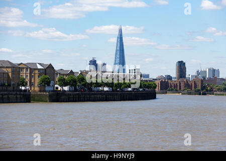 A view of London's skyline, including the Shard building.  As viewed from Canary Wharf.  14th July 2014. - Stock Photo