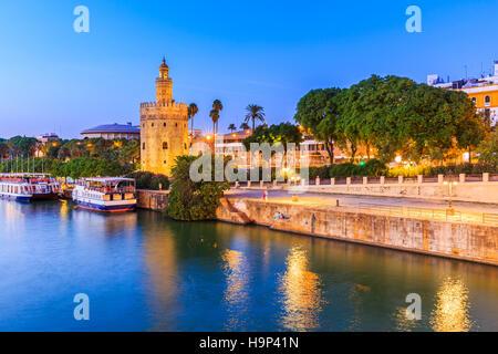 Seville, Spain. Guadalquivir river and Golden Tower (Torre del Oro) - Stock Photo