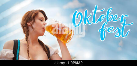 Oktoberfest Banner - German woman drinking beer - Stock Photo