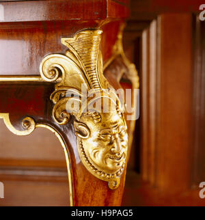 Detail of carved cabriole legs of C18th walnut tables in the Tapestry Room at Antony. Gilded carving at the knees - Stock Photo