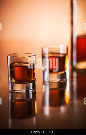 Glass of fine whiskey on counter close up - Stock Photo