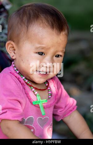 little Black Hmong girl in the tribal village Lao Chai in Sapa, Vietnam, Asia - Stock Photo
