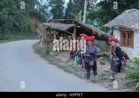 ethnic Red Dao women in the tribal village near Sapa, Vietnam, Asia - Stock Photo