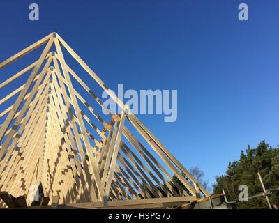 Low angle view of a new build roof under construction, installation and architecture design of geometric wooden - Stock Photo