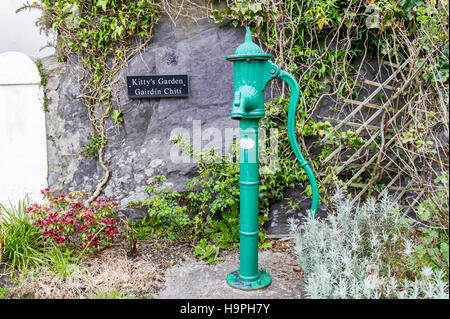 An old fashioned green water pump in Ballydehob, West Cork, Ireland. - Stock Photo