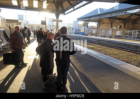 Passengers casting shadows on a railway platform, Perth,Scotland,UK - Stock Photo