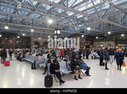 Glasgow Central Station - Passengers waiting on concourse - Stock Photo