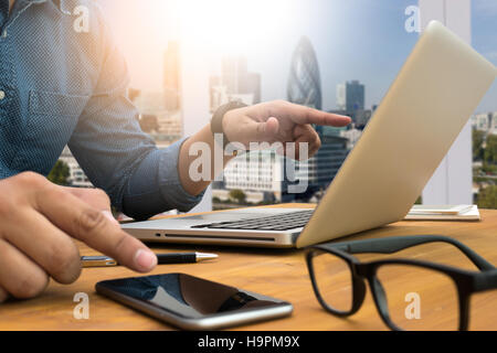 Cropped shot Silhouette of a man's hands using a laptop , young - Stock Photo