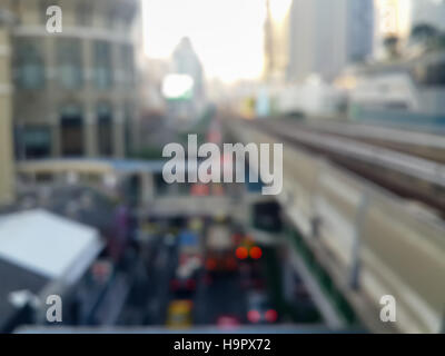 Blur city background of Bangkok Metropolis shot from high walkway connected to mass transit rail platform showing - Stock Photo