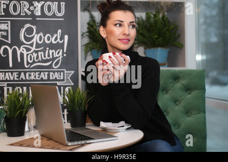 young couple meets in a cafe on a date - Stock Photo