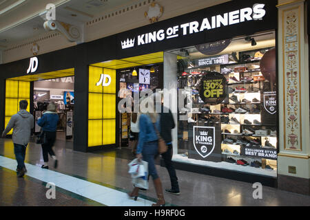 People passing JD sports King of Trainers at INTU Trafford Centre  Manchester. UK  25th November, 2016. Black Friday - Stock Photo