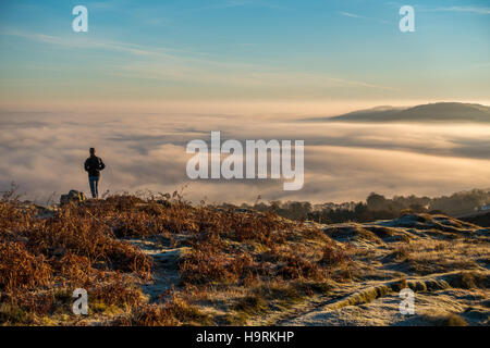 Ilkley, Leeds, West Yorkshire, UK. 26th November 2016. Extensive cold fog filled the valleys this morning around Yorkshire but people out early enjoyed a stunning temperature inversion on higher ground paths, Ilkley, West Yorkshire UK. Rebecca Cole/Alamy Live News
