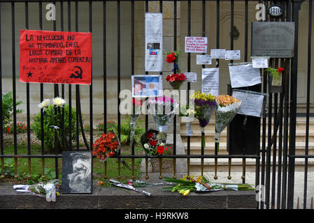 Buenos Aires, Argentina - Nov 26, 2016: Flowers and signs on a fence in memory of Cuba's revolutionary leader and - Stock Photo