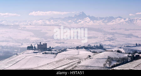 View of the Langhe and the Castle of Grinzane Cavour in winter with snow, Piedmont Italy Unesco heritage - Stock Photo