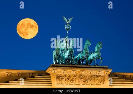 Full moon, Super moon, Supermoon, Vollmond, Supermond, Berlin brandenburg gate , paris square, quadriga - Stock Photo