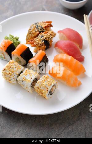 Traditional japanese sushi set on plate, food closeup - Stock Photo