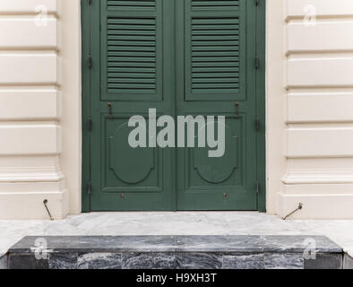 Green wooden door of the European style house. - Stock Photo