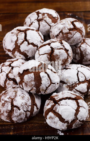 chocolate cookies crinkles on wooden table. copy space - Stock Photo
