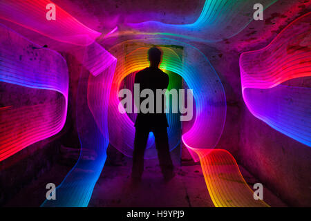 Light painting in damp rustic basement. - Stock Photo