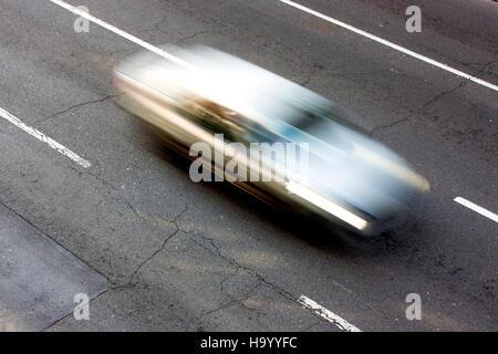 White  car speeding on the street in motion blur - Stock Photo