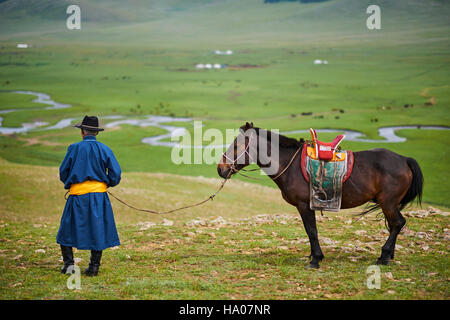Mongolia, Arkhangai province, yurt nomad camp in the steppe, Mongolian horserider - Stock Photo