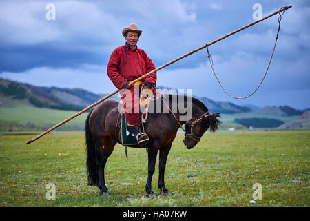 Mongolia, Ovorkhangai province, Orkhon valley, Nomad camp, Mongolian horserider with his urga to catch the horses - Stock Photo