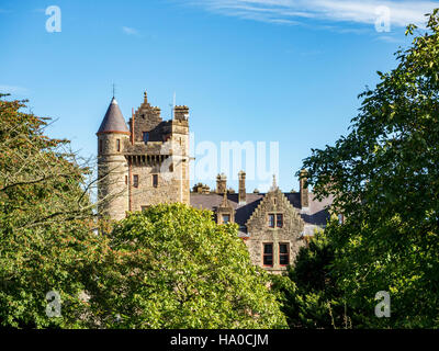 Belfast castle among trees. Tourist attraction on the slopes of Cavehill Country Park in Belfast, Northern Ireland - Stock Photo