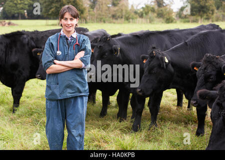 usdagov 16381027182 A veterinarian in field with cattle - Stock Photo
