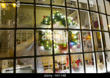 Christmas shop window in Churchtown, Southport, Merseyside, UK. - Stock Photo