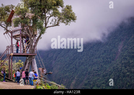 Treehouse giant swing in the Andes in Banos Ecuador - Stock Photo