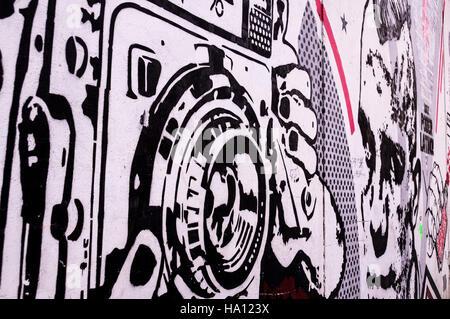 Retro polaroid camera street art - Stock Photo