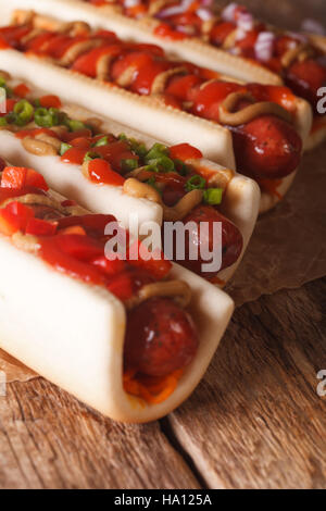 A variety of freshly made hot dogs macro on the table. vertical - Stock Photo
