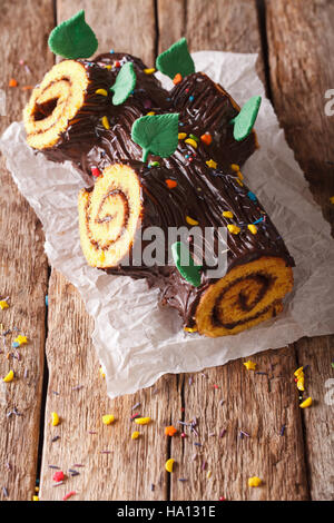 homemade buche de noel, chocolate yule log christmas cake. Vertical, rustic - Stock Photo