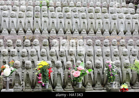 Rows of Jizo statues-bodhisattva who guards children specially those who died before their parents and the stillborn - Stock Photo